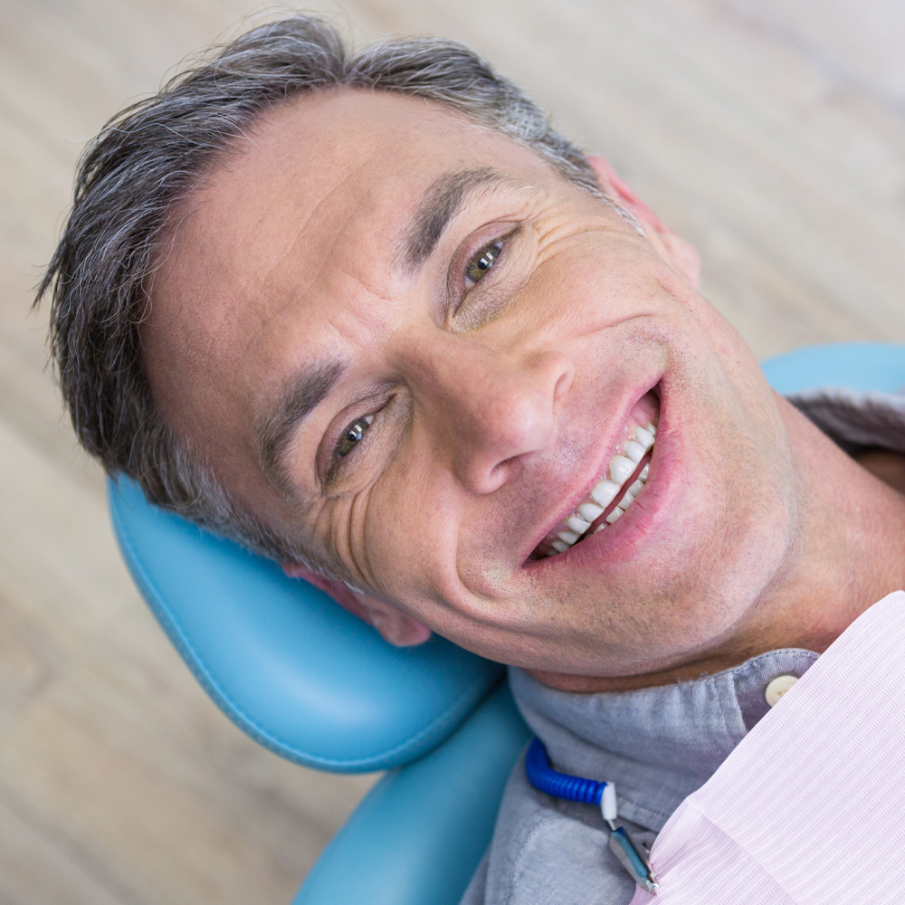 man smiling with new dentures from dr zaborski dentist